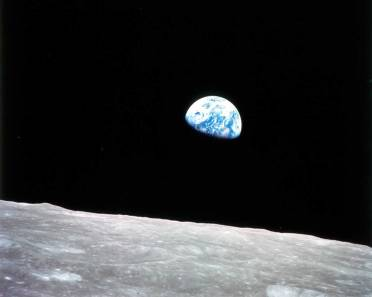 """Earthrise"" image taken by the Apollo 8 moon mission from about 240,000 miles (380,000 kilometers) away. URL: http://spaceindustrynews.com/cassini-probe-to-take-photo-of-earth-from-898-million-miles-away/"